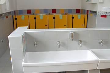 washbasins with very low taps in the toilets of a nursery