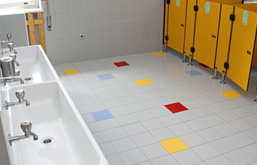 sinks and washbasins with low taps in the toilets of a nursery