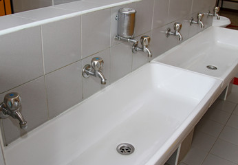 sinks and washbasins with taps in the toilets of a nursery