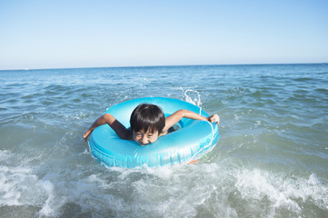 Boy Plays on the waves in the sea