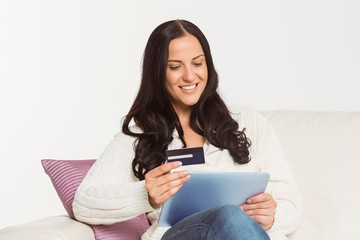 Woman sitting with tablet pc