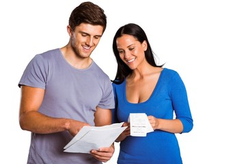 Young couple reading their bills