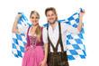 Bayrisches Paar in Tracht mit Rautenflagge
