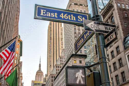 Fifth Avenue street signs and buildings - 69974989