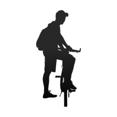 Silhouette of man with bicycle rear view