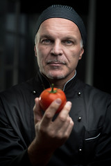 Chef holding a tomato
