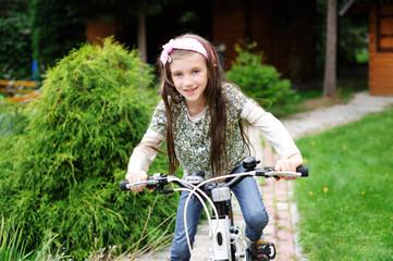 Kid girl on bicycle
