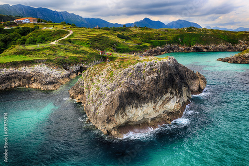 Fotobehang beautiful scenery with the ocean shore in Asturias, Spain