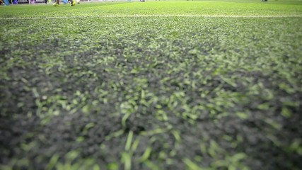 Soccer players on the field view only at their feet