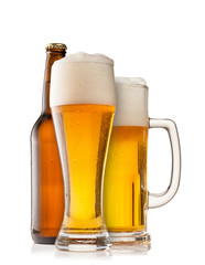Beer glasses with bottle on white background
