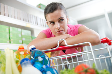 Exhausted woman at supermarket