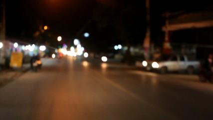 Motion Thai night street on motobike. Video blurred with bokeh