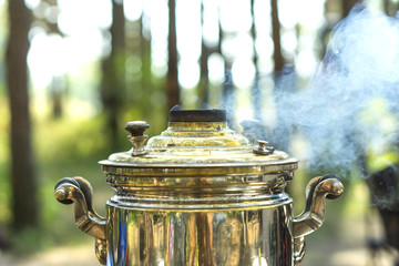 Close up of smoking russian samovar