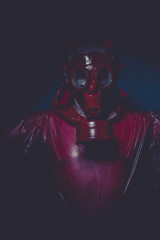 inhalation nuclear concept, man with red gas mask