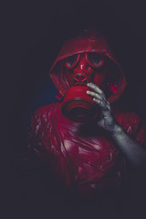 atomic nuclear concept, man with red gas mask