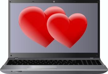 laptop i dwa czerwone serca