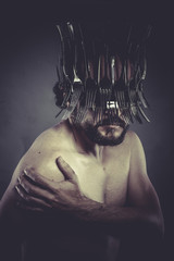 restaurant, Man with helmet made of forks and knives, concept