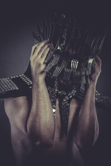 eating Man with helmet made of forks and knives, concept