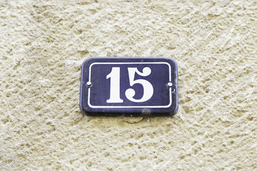 Number fifteen in a wall of a house