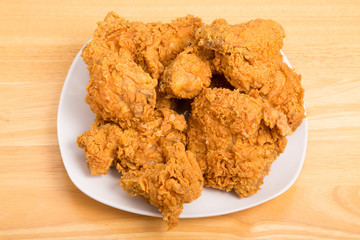 Square Plate of Fried Chicken on Wood Table