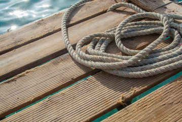 Rope on wooden floor near the sea