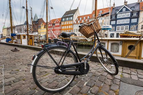 Classic vintage retro city bicycle in Copenhagen, Denmark - 69979164
