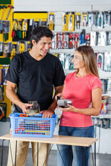 Couple Paying Through Credit Card In Hardware Store