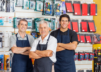 Salesmen Standing Arms Crossed In Hardware Shop