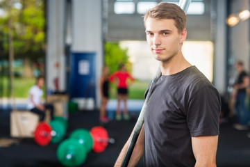 Confident Fit Man Holding Barbell Bar