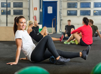 Portrait Of Woman Exercising In Cross Fitness Box