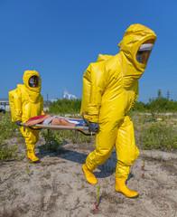 Mans in protective hazmat suit, blue sky