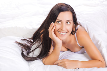 woman lying in the bed  and smiling