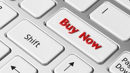 Buy Now on enter key of white keyboard closeup