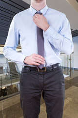 Businessman adjusting hit tie