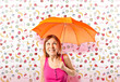 Girl holding an umbrella over colorful background