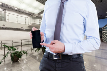 Office worker with smartphone