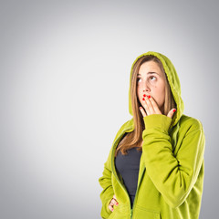 Girl doing surprise gesture over grey background