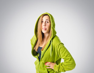 Young girl doing a joke over grey background
