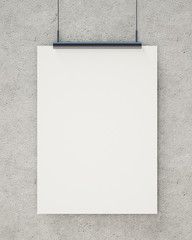 blank white hanging poster on concrete wall