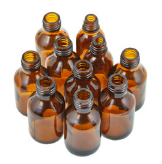 many small open brown glass oval pharmacy bottles