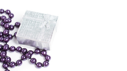 silver gift-box on white background, with purple necklace