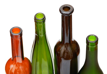 open bottlenecks of few colored wine bottles