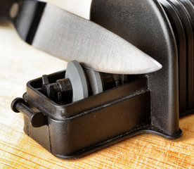Sharpening of knife in a kitchen