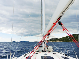 voyage on yacht in Adriatic sea over rainy clouds