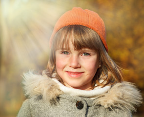 Smiling girl in an autumn park