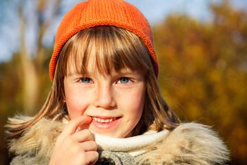 A girl in orange hat