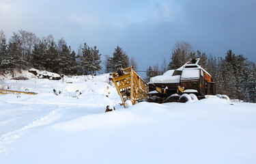 old abandoned crane in the snow