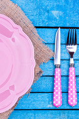empty plate and fork,knife on a blue wooden background