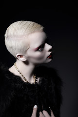 Individuality. Glamorous Blond Woman with Short Haircut