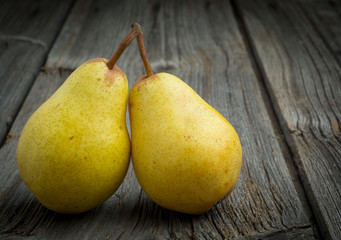 sweet pear closeup on wooden background